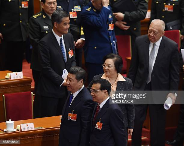Chinese President Xi Jinping and Premier Li Keqiang walk out after the opening session of the National People's Congress as Hong Kong Chief Executive...
