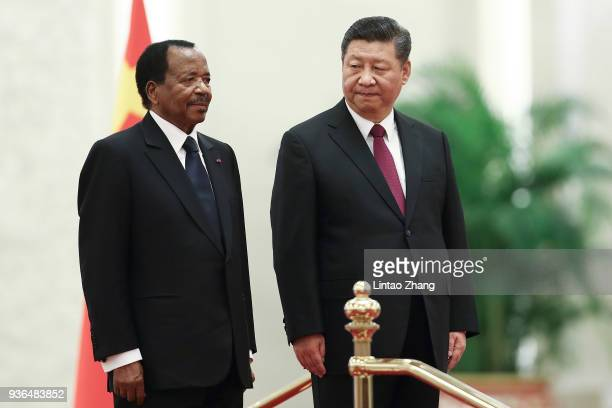 Chinese President Xi Jinping and President of Cameroon Paul Biya listen to their national anthems during a welcoming ceremony inside the Great Hall...