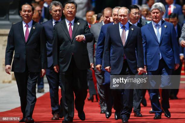 Chinese President Xi Jinping and Russian President Vladimir Putin arrive with other leaders for a family photo during the Belt and Road Forum at the...