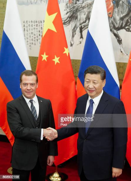 Chinese President Xi Jinping and Russian Prime Minister Dmitry Medvedev shake hands before talks at the Diaoyutai state guesthouse on November 1 2017...