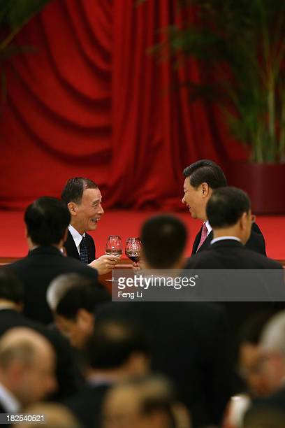 Chinese President Xi Jinping and Secretary of the Central Commission for Discipline Inspection Wang Qishan toast with highranking Chinese officials...