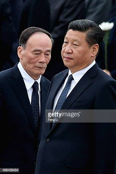 Chinese President Xi Jinping and Secretary of the Central Commission for Discipline Inspection Wang Qishan arrive the Monument to the People's Heroes...