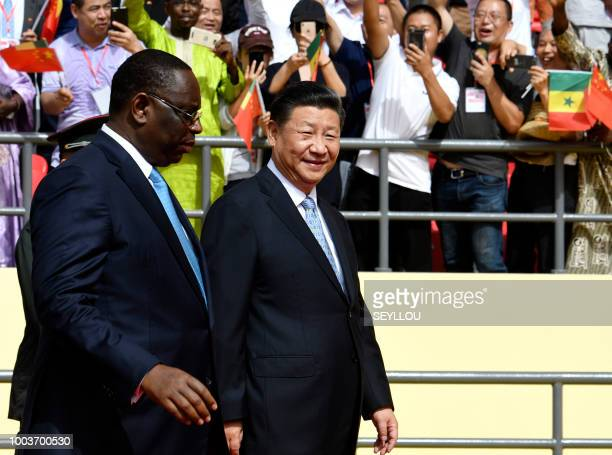 Chinese President Xi Jinping and Senegalese President Macky Sall arrive for the inauguration ceremony of a wrestling arena built by a Chinese company...