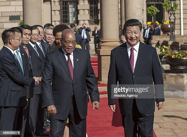 Chinese President Xi Jinping and South African president Jacob Zuma attend an official welcome prior to at the presidential palace in Pretoria South...