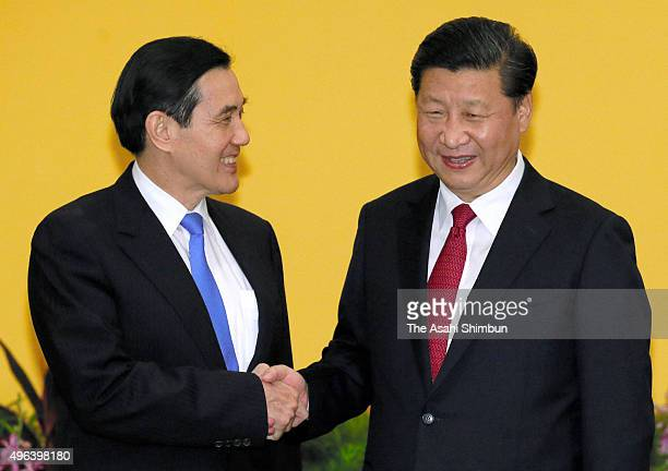 Chinese President Xi Jinping and Taiwanese President Ma YingJeou shake hands prior to their meeting at a hotel on November 7 2015 in Singapore