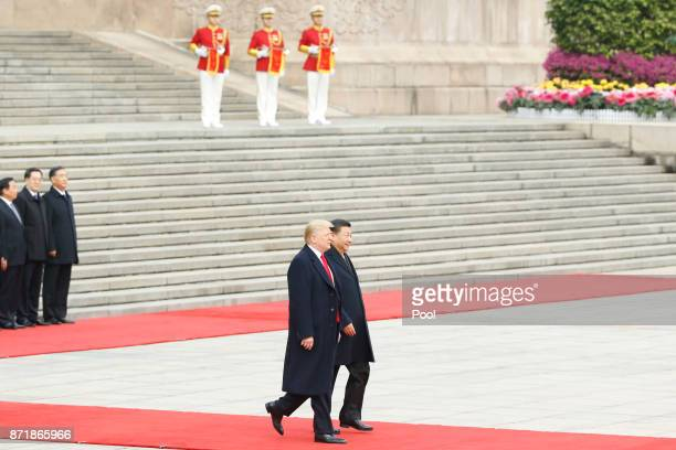 Chinese President Xi Jinping and US President Donald Trump attend a welcoming ceremony November 9 2017 in Beijing China Trump is on a 10day trip to...