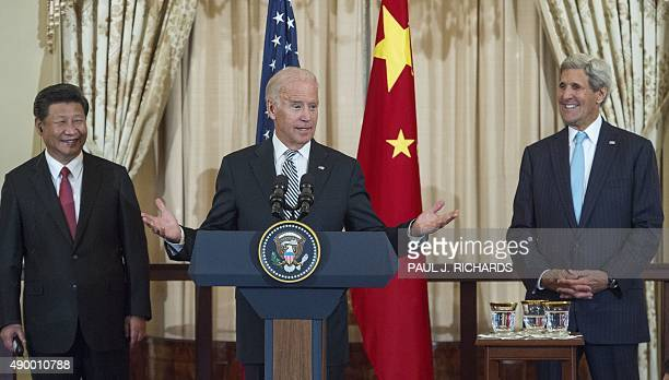 Chinese President Xi Jinping and US Secretary of State John Kerry listens as US Vice President Joe Biden speaks during a State Luncheon for China...