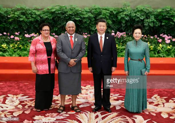 Chinese President Xi Jinping and wife Peng Liyuan welcome Fiji's Prime Minister Josaia Voreqe Bainimarama and his wife Maria Makitalena at the...