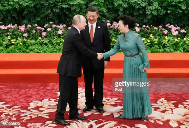 Chinese President Xi Jinping and wife Peng Liyuan welcome Russian President Vladimir Putin at the welcoming banquet for the Belt and Road Forum on...