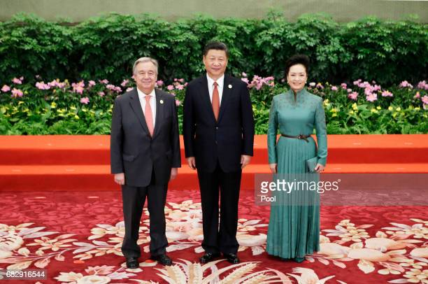 Chinese President Xi Jinping and wife Peng Liyuan welcome UN SecretaryGeneral Antonio Guterres at the welcoming banquet for the Belt and Road Forum...