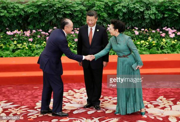 Chinese President Xi Jinping and wife Peng Liyuan welcome World Bank President Jim Yong Kim at the welcoming banquet for the Belt and Road Forum on...
