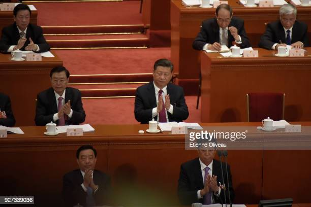 Chinese President Xi Jinping applauds during the opening session of the 13th National People's Congress at The Great Hall of People on March 5 2018...