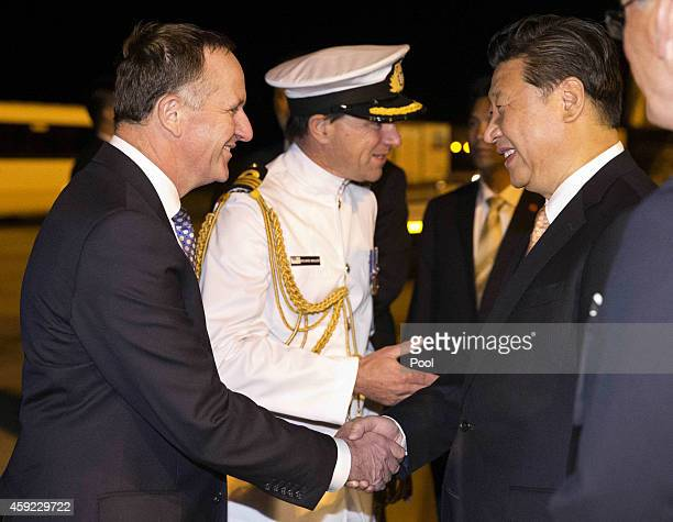 Chinese President Xi Jinping arrives at Auckland International Airport greeted by New Zealand Prime Minister John Key on November 19 2014 in Auckland...