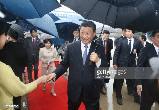 TOPSHOT Chinese President Xi Jinping arrives at Kansai airport in Izumisano city Osaka prefecture on June 27 2019 to attend the G20 Osaka Summit /...