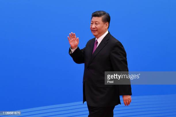 Chinese President Xi Jinping arrives for a press conference after the Belt and Road Forum at the China National Convention Center at the Yanqi Lake...
