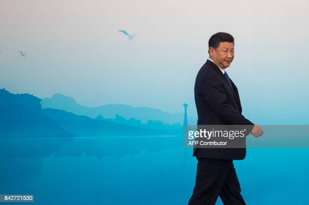TOPSHOT Chinese President Xi Jinping arrives for a press conference at the BRICS Summit in Xiamen Fujian province on September 5 2017 Xi opened the...