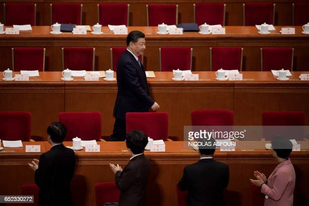 Chinese President Xi Jinping arrives for the third plenary session of the fifth session of the 12th National People's Congress at the Great Hall of...