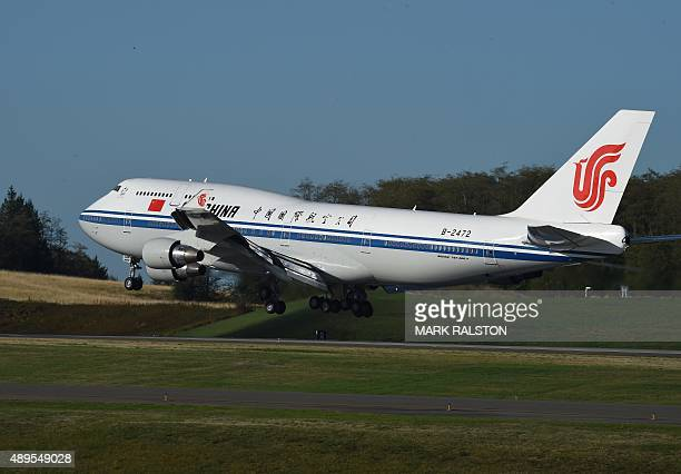 Chinese President Xi Jinping arrives on a Air China Boeing 747400 for a one week visit to the United States at Boeing's Paine Field in Seattle...