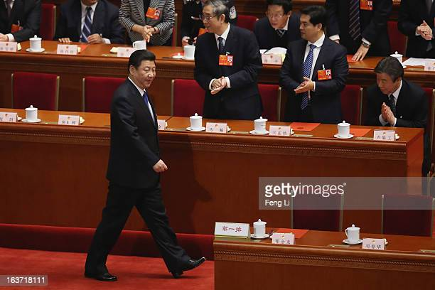 Chinese President Xi Jinping arrives the fifth plenary meeting of the National People's Congress at the Great Hall of the People on March 15 2013 in...