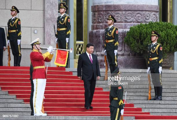 Chinese President Xi Jinping arrives to host a welcome ceremony for Russian President Vladimir Putin outside the Great Hall of the People in Beijing...