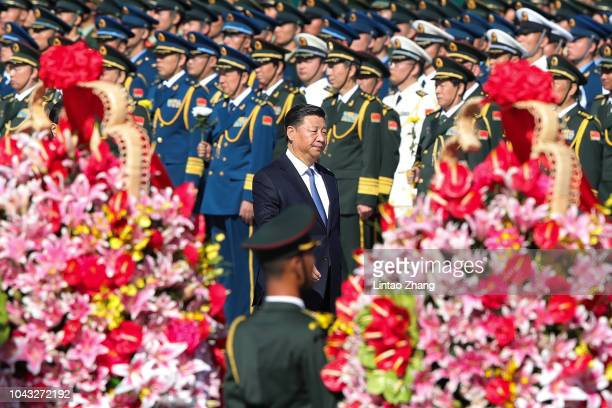 Chinese President Xi Jinping attend the a ceremony at Tiananmen Square on the eve of National Day on September 30 2018 in Beijing China On October 1...