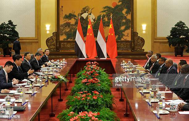 Chinese President Xi Jinping , attends a meeting with Sudanese President Omar al-Bashir at the Great Hall of the People on September 1, 2015 in...