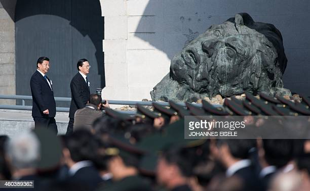 Chinese President Xi Jinping attends a memorial ceremony at the Memorial Hall of the Victims in Nanjing Massacre by Japanese Invaders on China's...