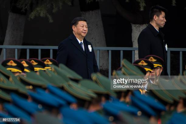 Chinese President Xi Jinping attends a memorial ceremony at the Nanjing Massacre Memorial Hall on the second annual national day of remembrance to...