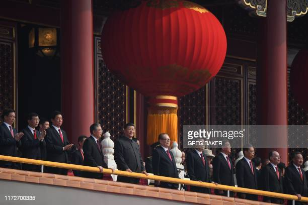 Chinese President Xi Jinping attends a military parade with former presidents Hu Jintao and Jiang Zemin in Tiananmen Square in Beijing on October 1...