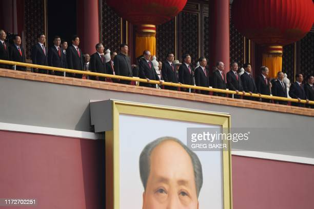 Chinese President Xi Jinping ) attends a military parade with former presidents Hu Jintao and Jiang Zemin in Tiananmen Square in Beijing on October 1...