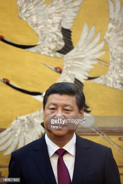 Chinese President Xi Jinping attends a signing ceremony with King Abdullah II bin Al Hussein of Jordan at the Great Hall of People on September 18...