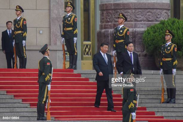 Chinese President Xi Jinping attends a welcoming ceremony for the Sultan of Brunei Hassanal Bolkiah outside the Great Hall of the People on September...