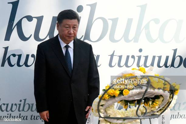 Chinese President Xi Jinping attends a wreath laying ceremony at the Kigali Genocide Memorial centre on July 23, 2018 during a two-day state visit in...