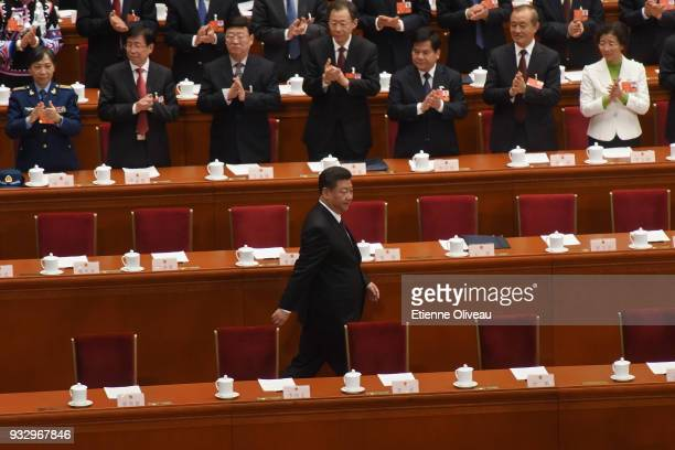 Chinese President Xi Jinping attends the 5th plenary session of the first session of the 13th National People's Congress at the Great Hall of the...