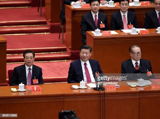Chinese President Xi Jinping attends the closing of the 19th Communist Party Congress with former Chinese presidents Jiang Zemin and Hu Jintao at the...