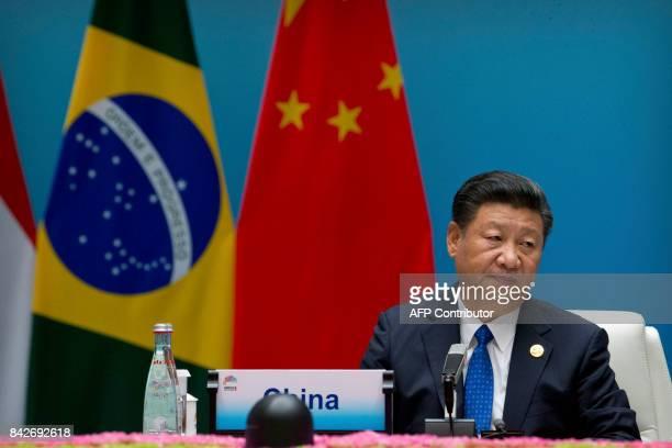 Chinese President Xi Jinping attends the Dialogue of Emerging Market and Developing Countries on the sidelines of the 2017 BRICS Summit in Xiamen,...