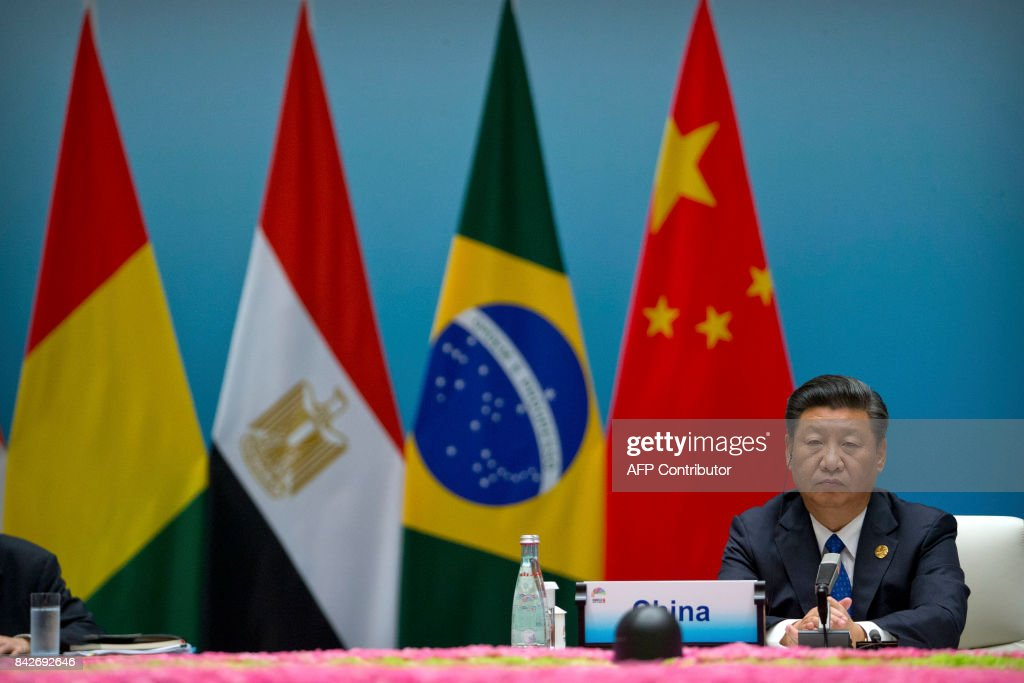 Chinese President Xi Jinping attends the Dialogue of Emerging Market and Developing Countries on the sidelines of the 2017 BRICS Summit in Xiamen, southeastern China's Fujian Province on September 5, 2017. Xi opened the annual summit of BRICS leaders that already has been upstaged by North Korea's latest nuclear weapons provocation. / AFP PHOTO / POOL / Mark Schiefelbein