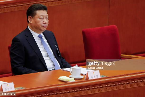 Chinese President Xi Jinping attends the opening session of the National People's Congress at The Great Hall of People on March 5 2017 in Beijing...