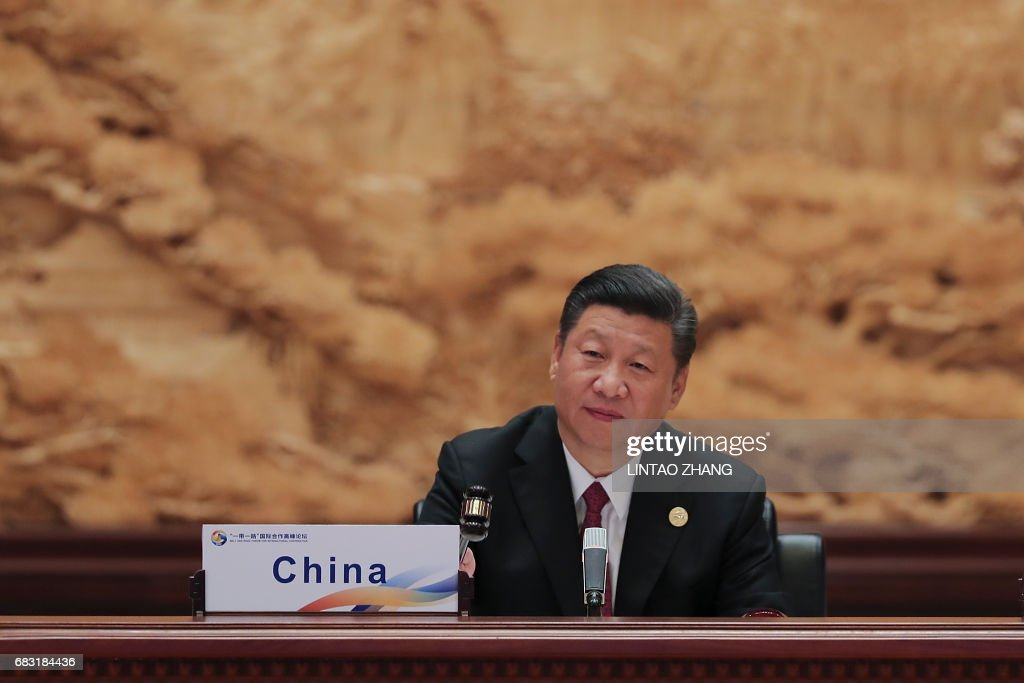 Chinese President Xi Jinping attends the Roundtable Summit Phase One Sessions during the Belt and Road Forum, at the International Conference Center in Yanqi Lake, north of Beijing, on May 15, 2017. Chinese President Xi Jinping urged world leaders to reject protectionism on May 15 at a summit positioning Beijing as a champion of globalisation, as some countries raised concerns over his trade ambitions. / AFP PHOTO / POOL / Lintao Zhang