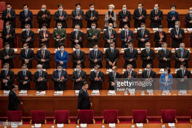 Chinese President Xi Jinping, bottom center, and Premier Li Keqiang, bottom left, are applauded by members of the government as they arrive at the...