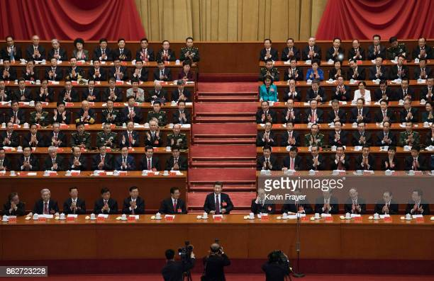 Chinese President Xi Jinping, bottom center, is applauded by senior members of the government after his speech at the opening session of the 19th...