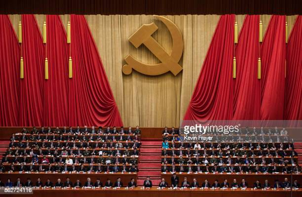 Chinese President Xi Jinping bottom center is applauded by senior members of the government after his speech at the opening session of the 19th...