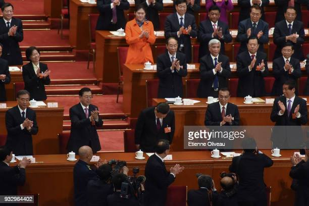 Chinese President Xi Jinping bows after hearing the results of his elected for a second fiveyear term during the 5th plenary session of the first...
