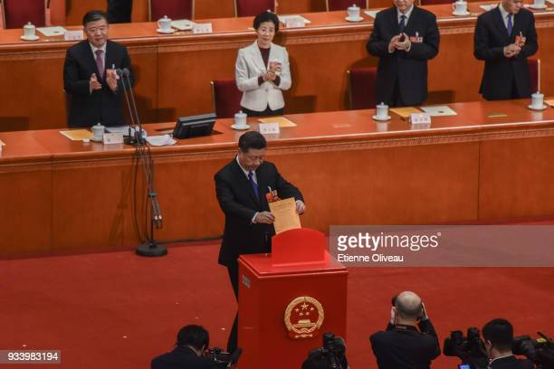 Chinese President Xi Jinping casts his vote during the seventh plenary session of the 13th National People's Congress at the Great Hall of the People...