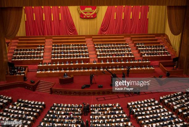 Chinese President Xi Jinping, center, and lawmakers gather at the second plenary session of the National People's Congress at the Great Hall of the...