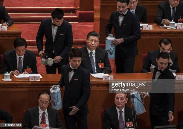 Chinese President Xi Jinping center and other high ranking members of the government are served tea during the third plenary session of the National...