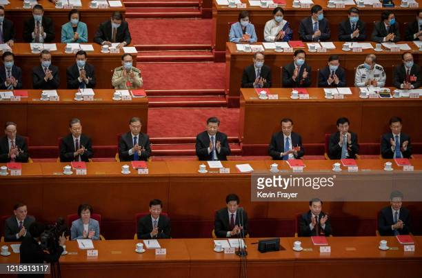 Chinese president Xi Jinping center and premier Li Keqiang center right and other members of the politburo and government applaud after the results...