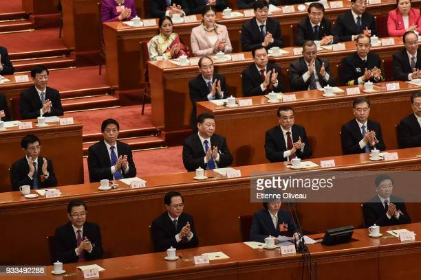 Chinese President Xi Jinping Chinese Premier Li Keqiang and Chairman of the National People's Congress Li Zhanshu applaud with other members of the...