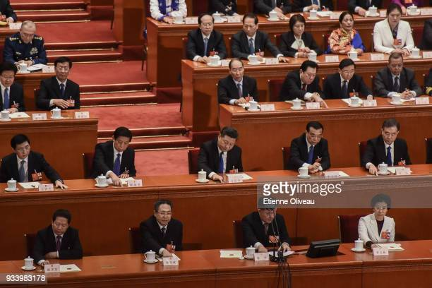 Chinese President Xi Jinping Chinese Premier Li Keqiang and Chairman of the NPC Li Zhanshu with other officials cast their vote during the seventh...