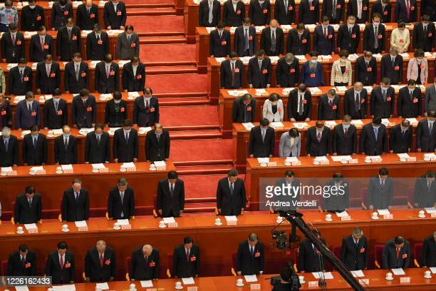 Chinese President Xi Jinping , Chinese Premier Li Keqiang and member of the Standing Committee of the Politburo Li Zhanshu and other attendees bow...